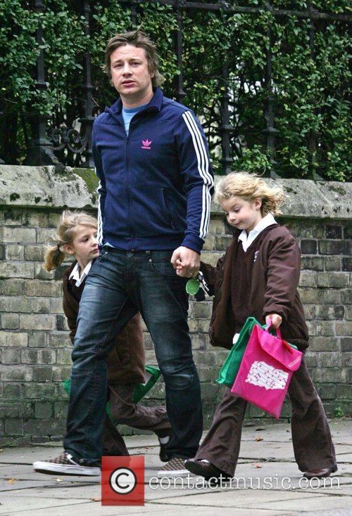 Collecting his children, Poppy and Daisy, from school