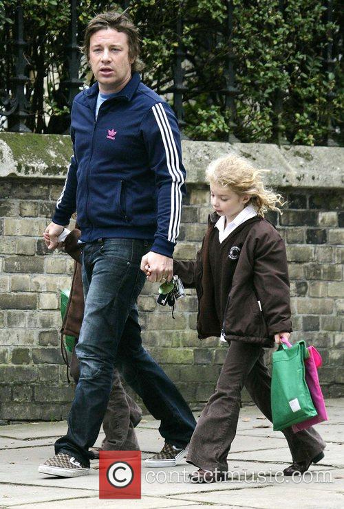 Jamie Oliver collecting his children, Poppy and Daisy,...