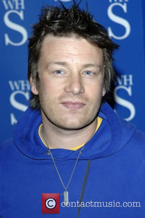 Jamie Oliver signs copies of his monthly food...