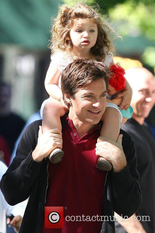 Jason Bateman carries his daughter, Francesca, on his...