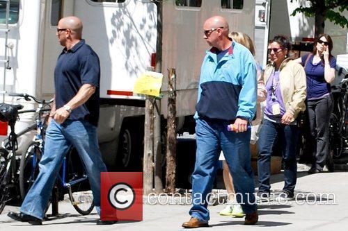 Jennifer Aniston's security guards escort her off the...