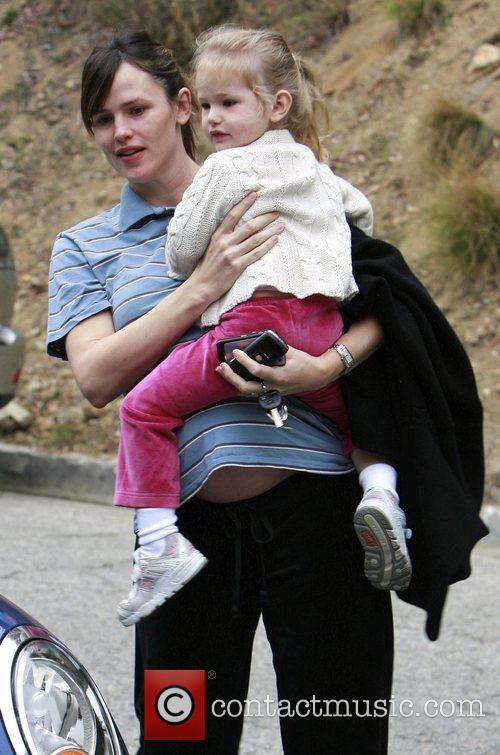 Jennifer Garner shows off her baby bump whilst...