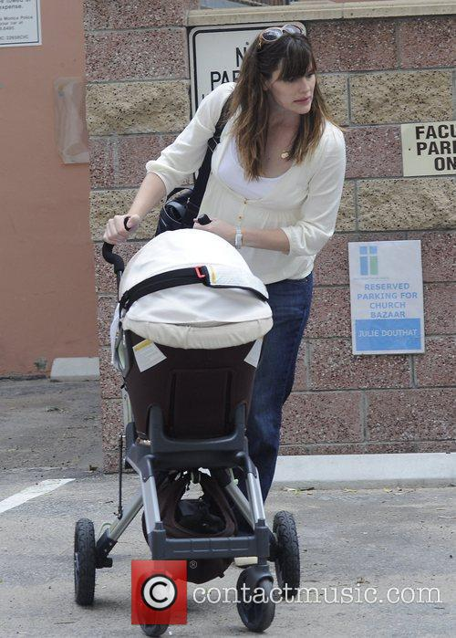 Jennifer Garner pushing her three month old baby,...