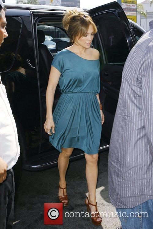 Wears a teal off-the-shoulder dress while on the...