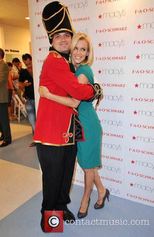 Jenny McCarthy poses with a toy soldier as...