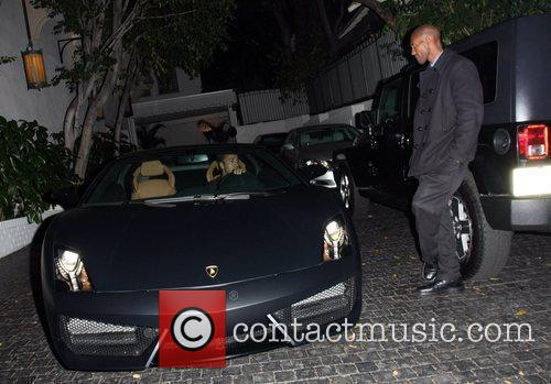 Leaves Chateau Marmont in his sports car
