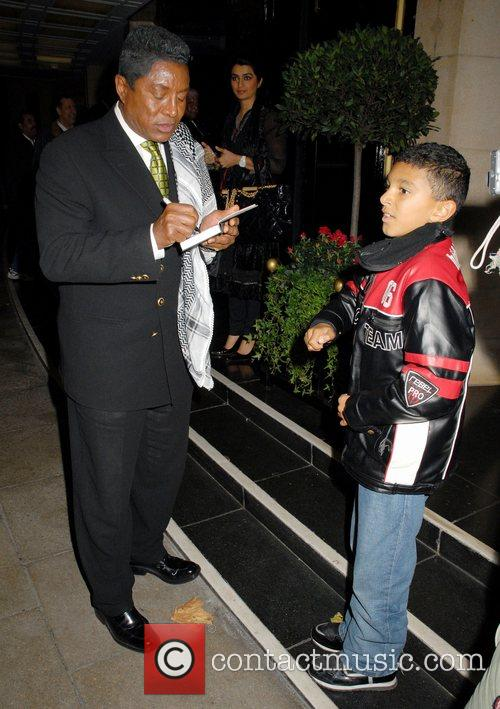 Jermaine Jackson at the Dorchester Hotel signing an...