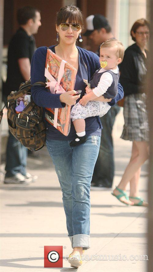 Jessica Alba carrying her daughter, Honor Marie, leaving...