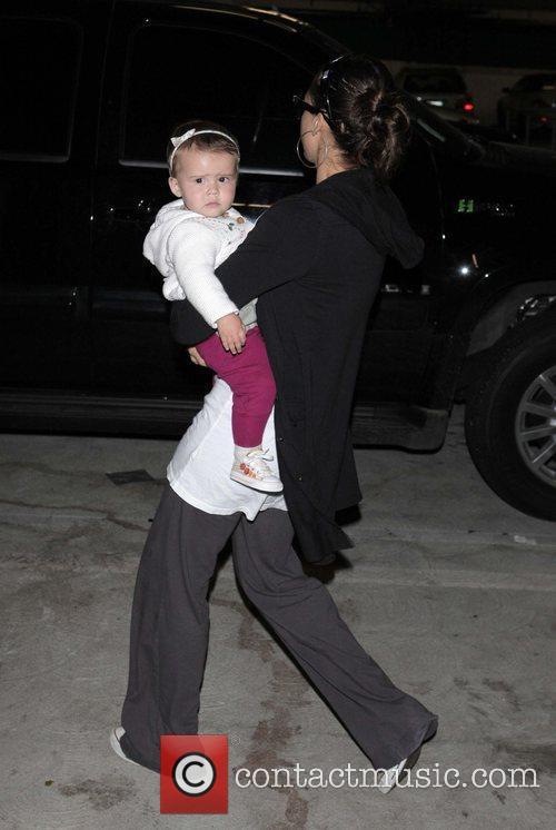 Jessica Alba and daughter Honor Marie walk back...