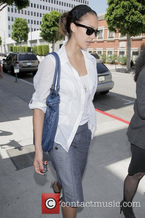 Jessica Alba returns to her car after visiting...