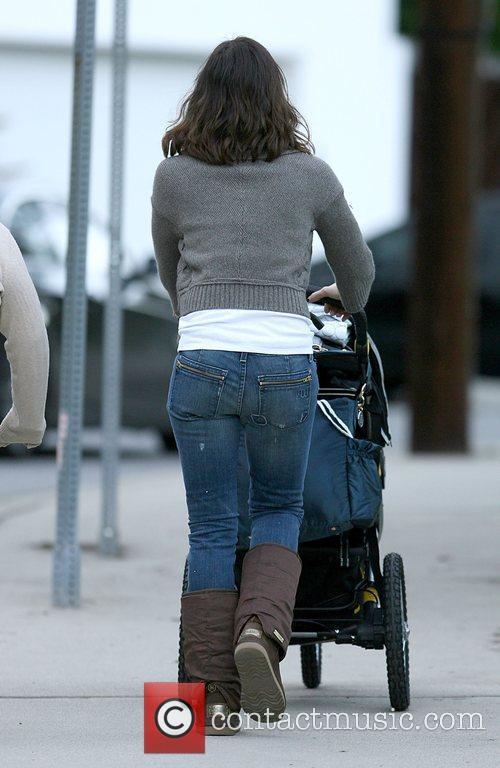 Jessica Alba enjoying a walk pushing her daughter...