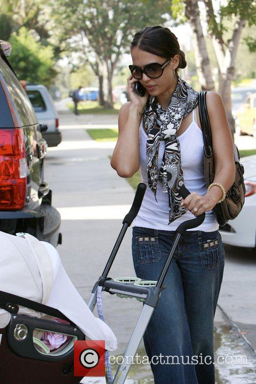 Jessica Alba talks into her cellphone as she...