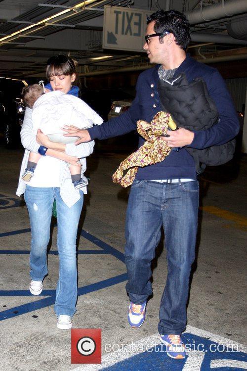 Jessica Alba carries her sleeping daughter Honor Marie...