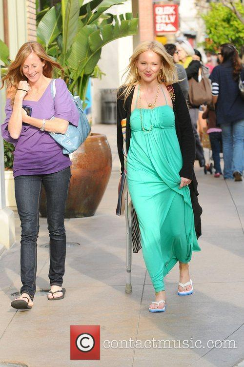 Jewel walking with a crutch while out shopping...