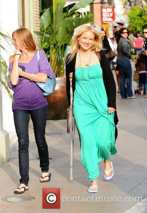 Walking with a crutch while out shopping with...