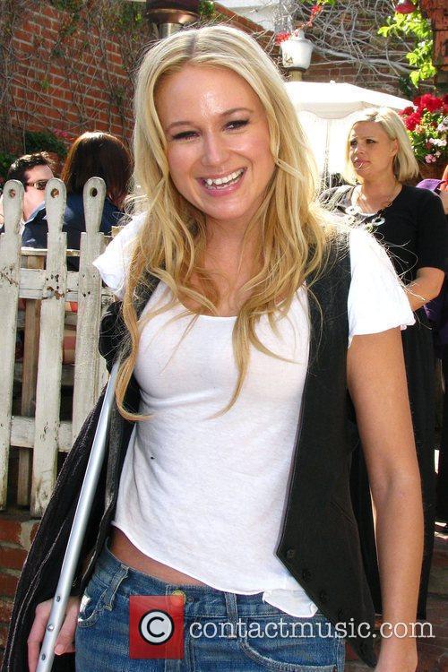 Jewel leaving the Ivy restaurant on crutches. Jewel...