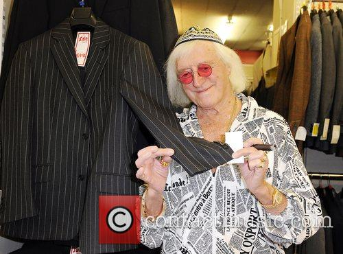 Sir Jimmy Savile checks out a suit at...