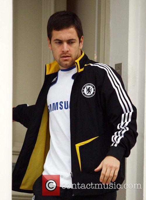 Joe Cole leaving his house wearing a Chelsea...