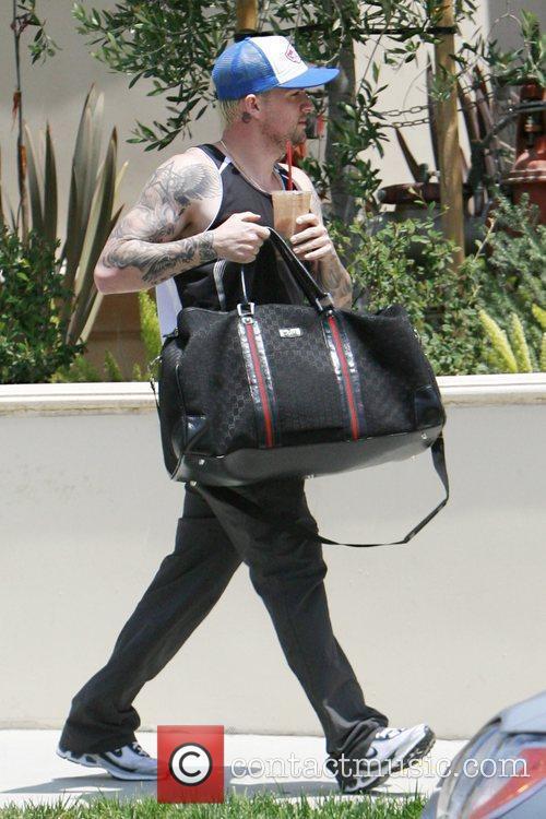 Joel Madden leaving a friend's residence in West...