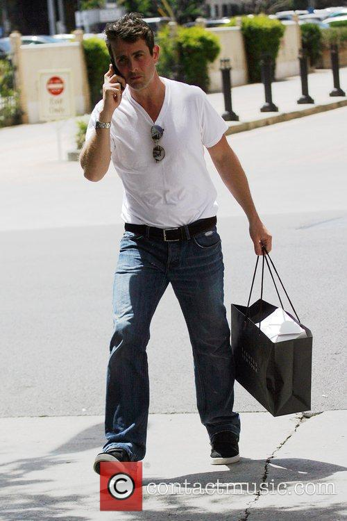 Joey McIntyre talking in his cellphone while leaving...