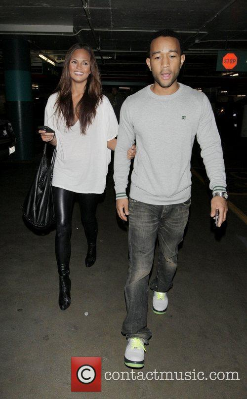 John Legend and His Girlfriend Christy Teigen Go Shopping At Intermix 5