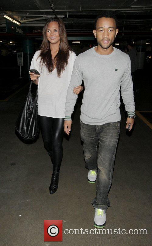 John Legend and His Girlfriend Christy Teigen Go Shopping At Intermix 6