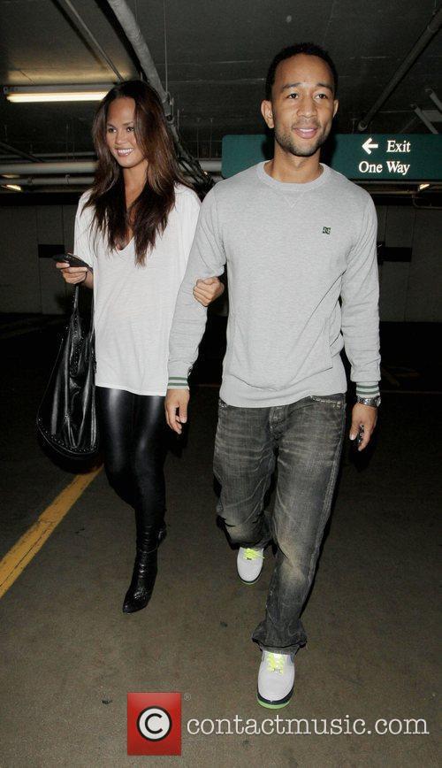John Legend and his girlfriend Christy Teigen go shopping at Intermix 12