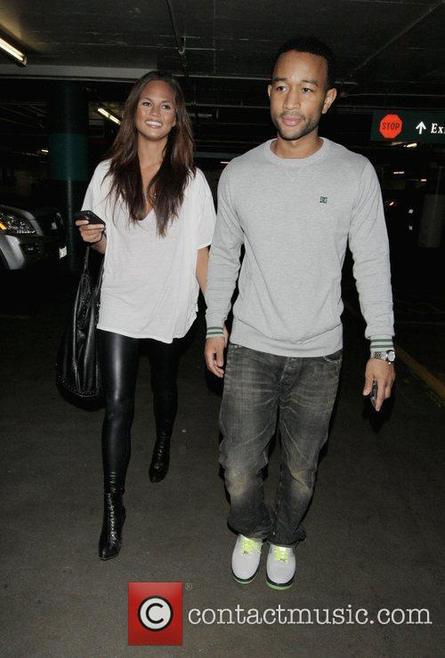 John Legend and His Girlfriend Christy Teigen Go Shopping At Intermix 4