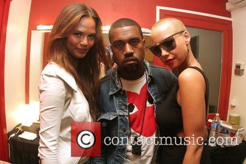 Kanye West and Amber Rose (right) backstage at...