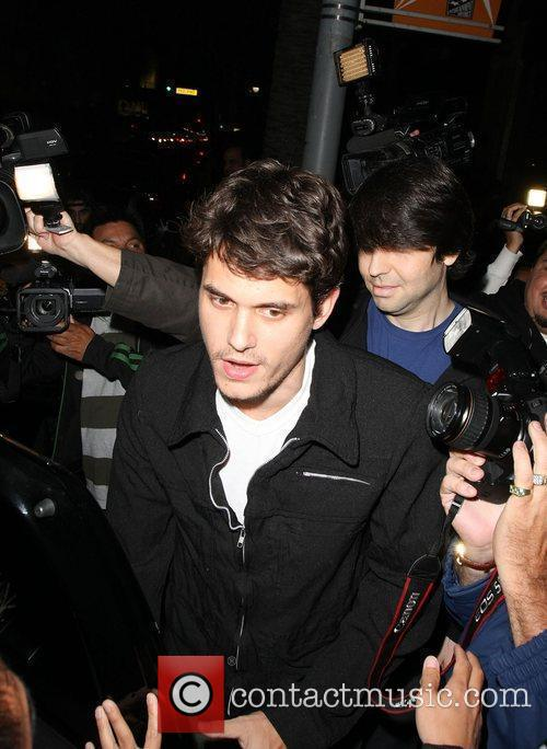 Is surrounded by photographers as he leaves Katsuya...