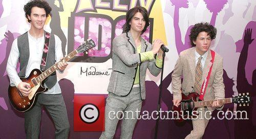 Jonas Brothers waxwork is unveiled at Madame Tussauds,...