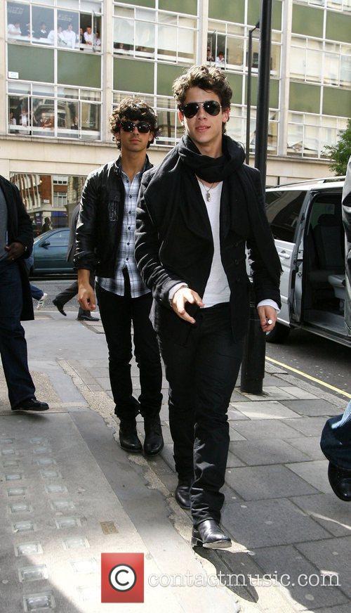Joe Jonas and Nick Jonas arrive at Radio...