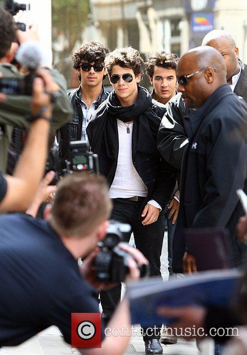 Nick Jonas, Joe Jonas and Kevin Jonas arriving...