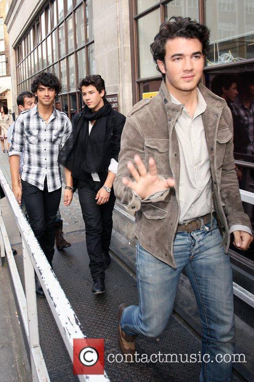 Nick Jonas, Joe Jonas and Kevin Jonas arrive...