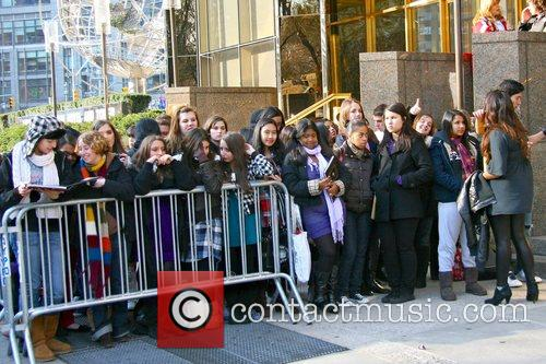 Fans The Jonas Brothers arrive back at their...