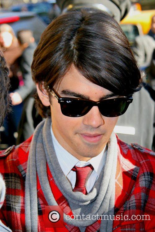 Joe Jonas The Jonas Brothers arrive back at...