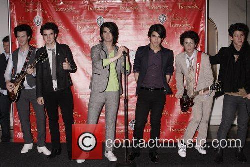 Kevin Jonas, Joe Jonas and Nick Jonas pose...