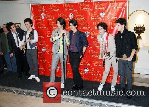 The Jonas Brothers' waxwork figures are unveiled at...