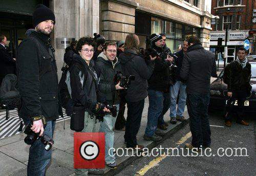 Photographers wait outside the BBC Radio 2 studios...