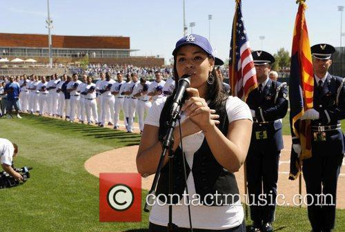 Performs the US National Anthem at the Los...