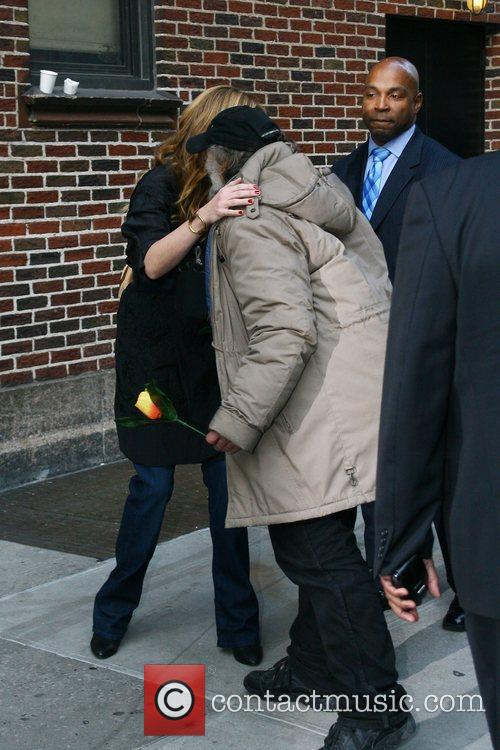 Julia Roberts receives flowers from radio man outside...