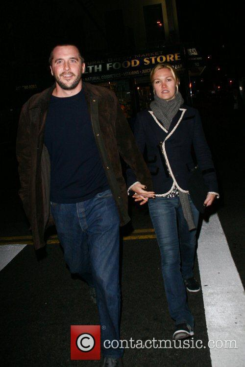 Julia Stiles  holds hands with mystery man...
