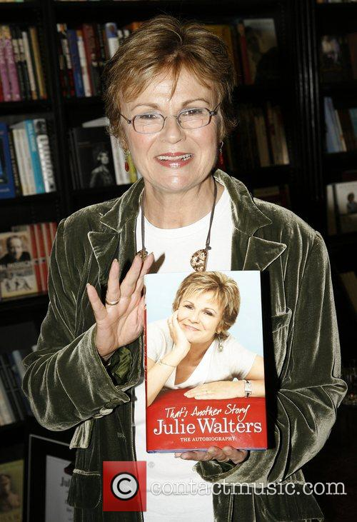 Signs copies of her new book 'That's Another...
