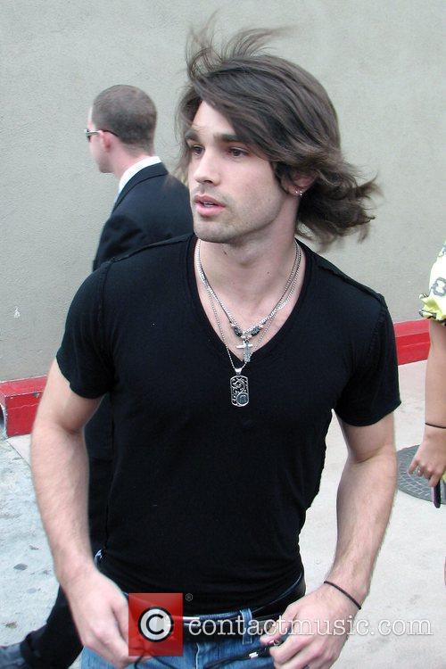 Justin Gaston arriving outside El Capitan theatre in...