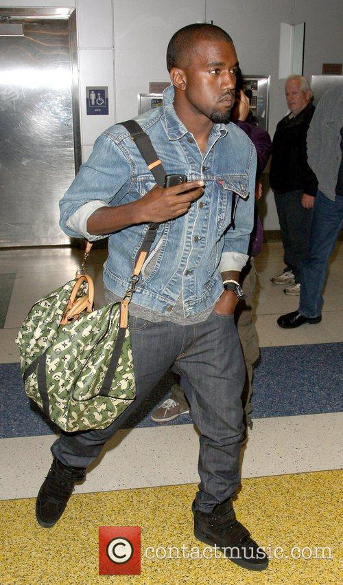Kanye West arriving at arriving JFK International Airport...