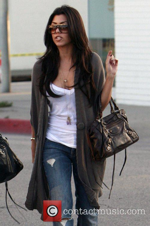 Kourtney Kardashian goes shopping with her sister and...
