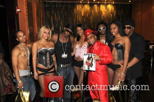 Pretty Ricky posing with model Grand re-opening of...