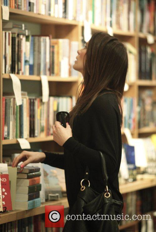 Kate Beckinsale shops for clothes and books in...