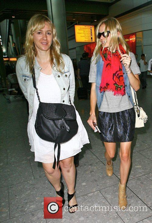Arrives at Heathrow airport with a friend after...