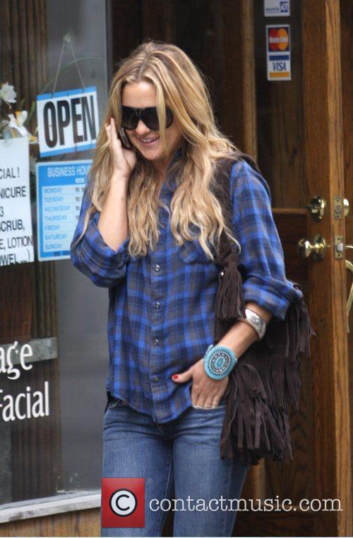 Kate Hudson walking through Soho chatting on her...